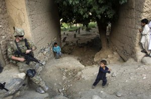 US Army infantry soldier protecting Afghan children