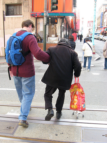 Helping an elderly lady cross a street