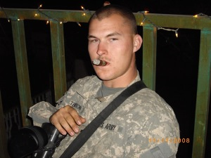 soldier enjoying a smooth stogie